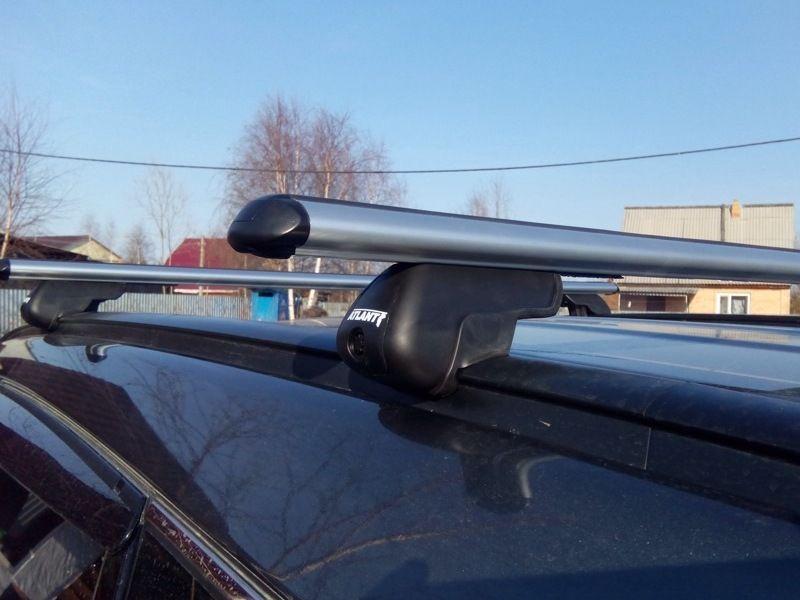Багажник на крышу Hyundai Santa Fe 2012-..., аэродинамические дуги на интегрированные рейлинги, Атлант