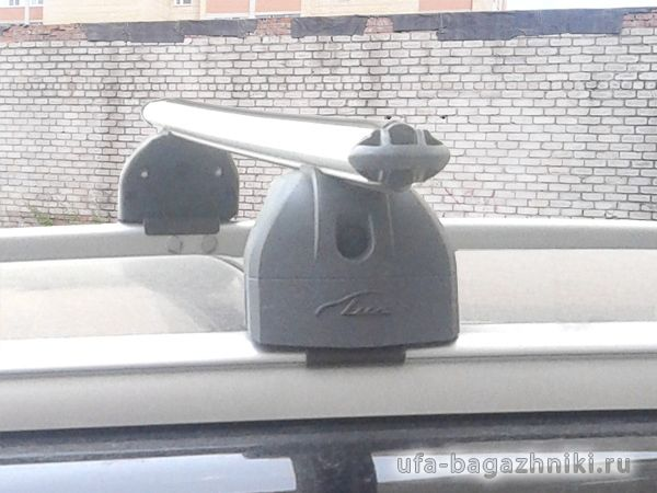 Багажник на крышу Hyundai Santa Fe 2012-..., Lux, аэродинамические дуги на интегрированные рейлинги