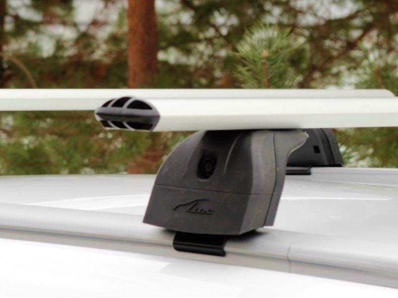 Багажник на крышу Geely Atlas 2017-..., Lux, аэродинамические дуги (73 мм) на интегрированные рейлинги
